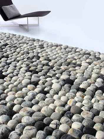alfombra lana piedras