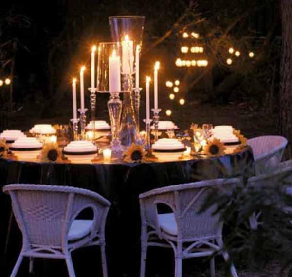 Mesas velas en exterior