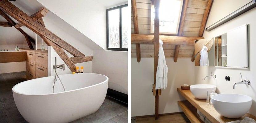 Vigas de madera en baño en el ático