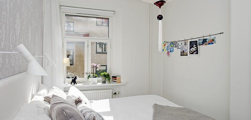Dormitorio escandinavo tonos grises