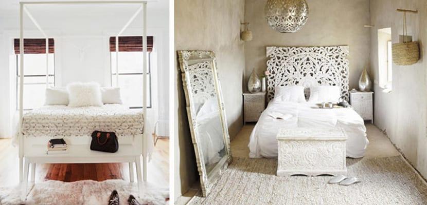 Muebles blancos a pie de cama