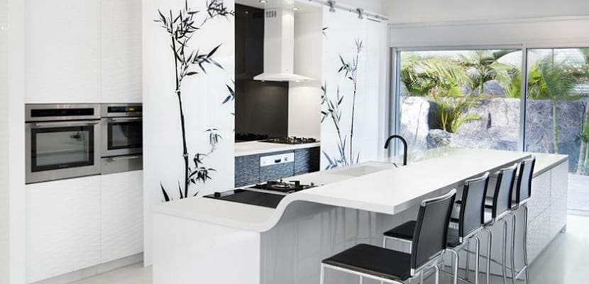Cocinas con isla ventajas e ideas - Isla de cocina con mesa ...
