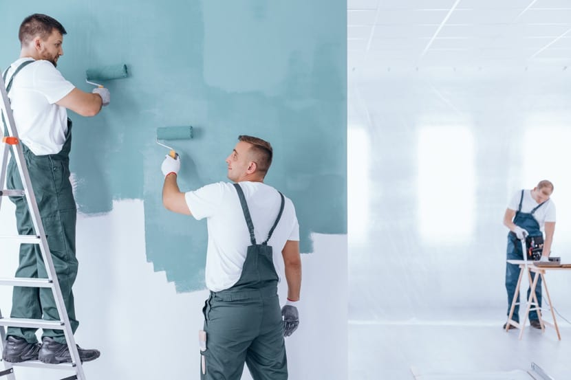 hombres pintado pared azul